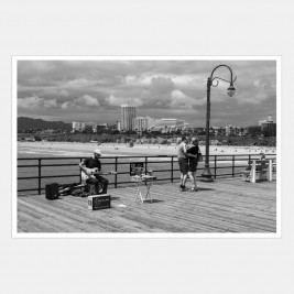 Couple dancing on Santa Monica pier, California, USA