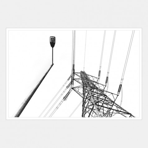 An Electric Pylon with a Lamp Post in the Foreground | 1 of 2