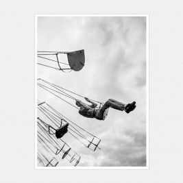 A Man on a Swing Ride at a Fair