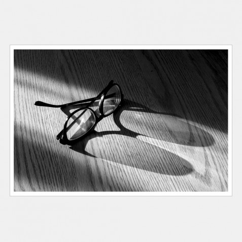 A pair of sunglasses on the dining room table