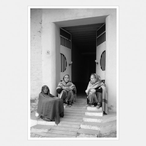 Three Women Seated on Steps, Punjab, India.