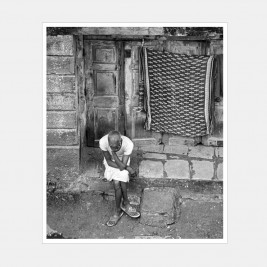 Man sitting on a door step lost in thought, mumbai, India